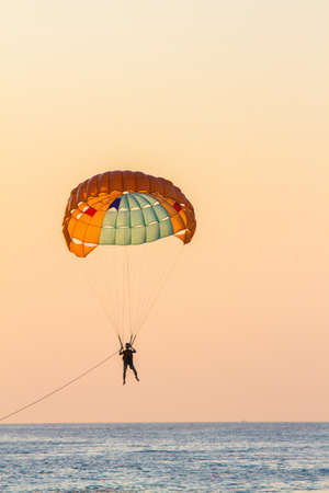 parasailing: Parasailing in the eveing, taken in Phuket Patong Beach, Thailand