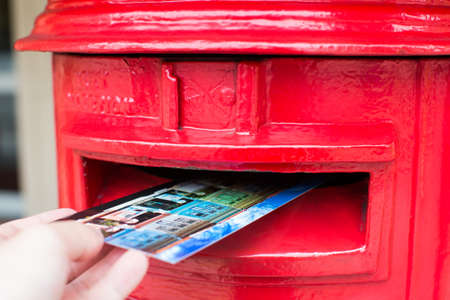 pillar box: Traditional Red Postbox with postcard dropping