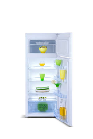 open small refrigerator with food, fruits, isolated on white background photo