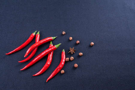 ot: hot red pepper with nuts ot dark background Stock Photo