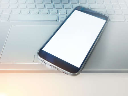 hone: Business concept, smartp hone with blank screen and laptop. Mockup