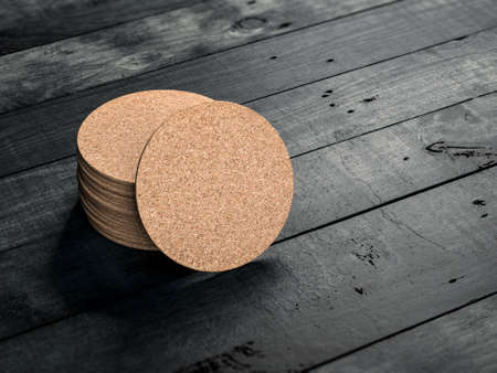Stack of Round Cork pads, beer coaster Mockup on the black wooden table