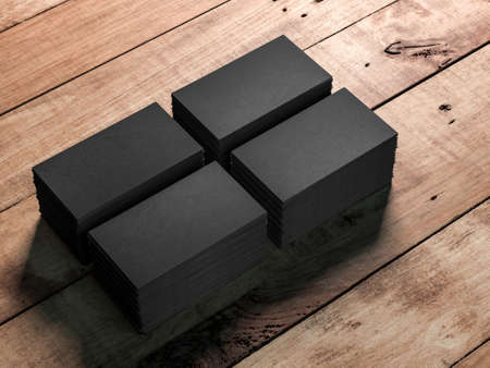 Four Stacks of black business cards on wooden table background