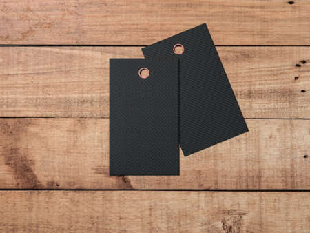 Two Black textured tags or labels Mockup on wooden table, show your price or discount