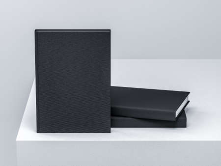 Blank black Book Mockup on white table in light studio Stock Photo