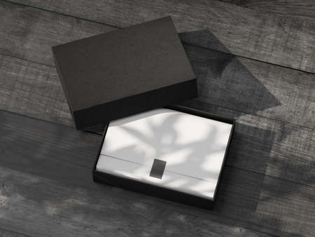 Opened black Gift Box Mockup with white wrapping paper on the wooden table outdoor 写真素材