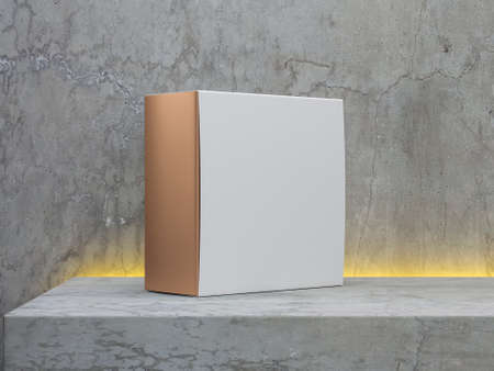 Square golden box packaging with white cover on concrete shelf with modern led illumination light 写真素材