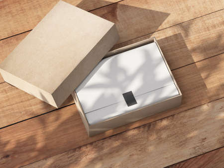 Opened carton Gift Box Mockup with white wrapping paper on the wooden table outdoor 写真素材