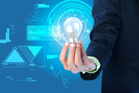 Business idea  Businessman holding light bulb  photo