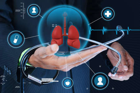 Smart hand showing human lungs and stethoscope