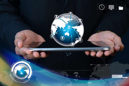 Businessman showing tablet with global networking