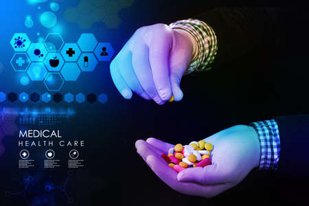 doctor holding in hands pills photo