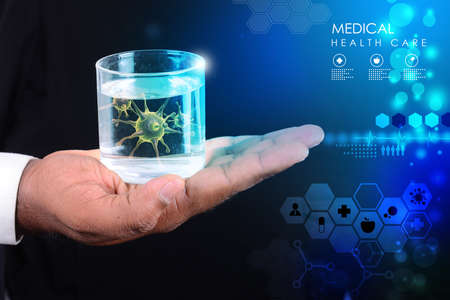 purified: Smart hand showing virus in glass of water   Stock Photo