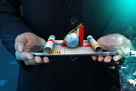 Business man showing growth graph and  globe photo