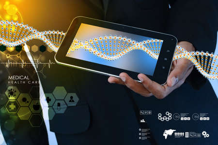 geneticist: Smart hand showing tablet pc with DNA interface