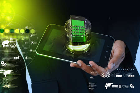 Smart phone with chain in glass, safety concept photo