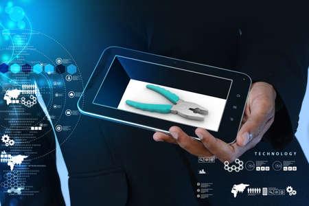 smart phone hand: Smart hand showing smart phone repair service concept Stock Photo