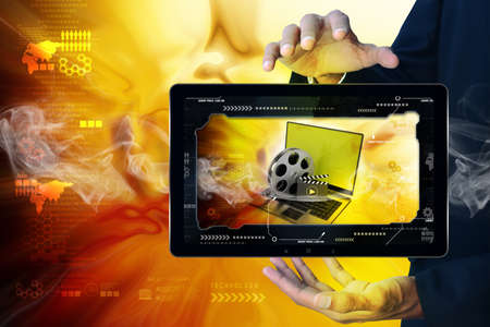 Smart hand showing Laptop with reel in frame photo