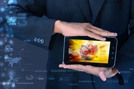 Man showing Earth globe close in chain   in tablet computer photo