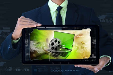 man showing Laptop with reel in frame photo