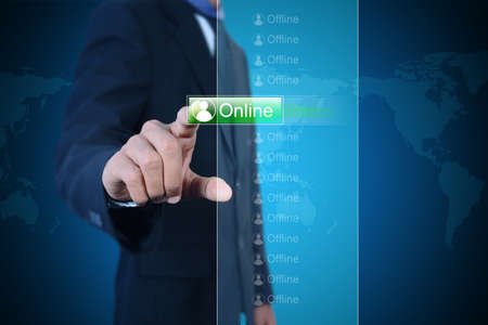 Businessman pressing virtual buttons Stock Photo