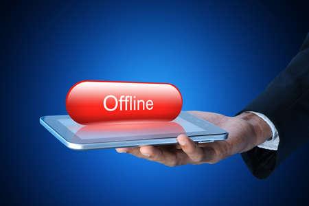offline: Man showing Tablet computer with offline concept
