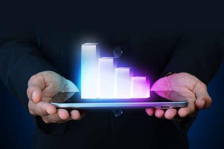 businessman showing digital graph photo