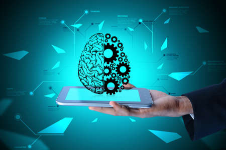 Man showing brain and gear wheels on smart phone in color back ground