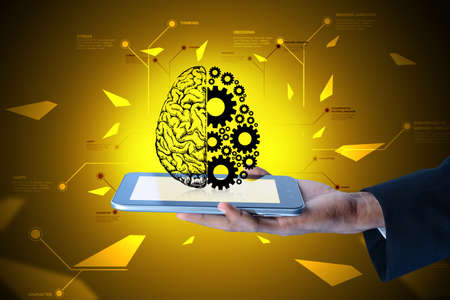 gear wheels: Man showing brain and gear wheels on smart phone in color back ground