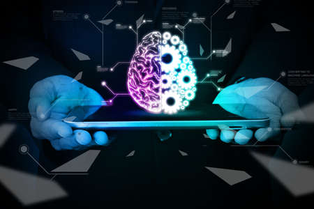 back ground: Man showing brain and gear wheels on smart phone in color back ground