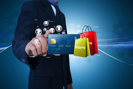shopping cart isolated: Business man showing Online shopping concept in color background