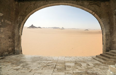 dehydration: Old architectural arch in the background of the desert.
