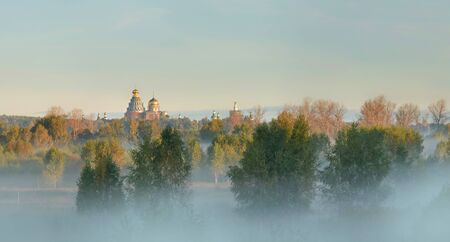 Earlier the morning with settled fog in rural Russia. Stock Photo