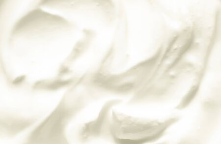 The texture of the white,fresh dairy sour cream.