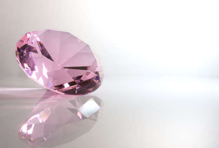 Faceted Round Pink Kunzite Gemstone with Reflection Isolated on White Background