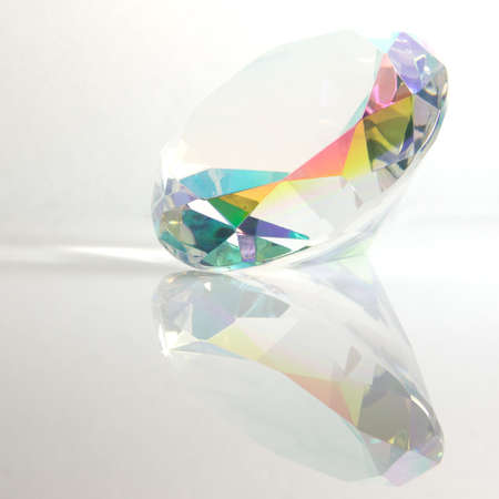 Faceted Round Mystic Topaz with Reflection on White Background