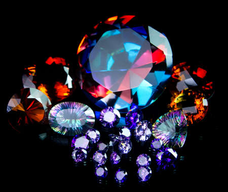 gemstone: Faceted Gemstone Collection Isolated on Black Background