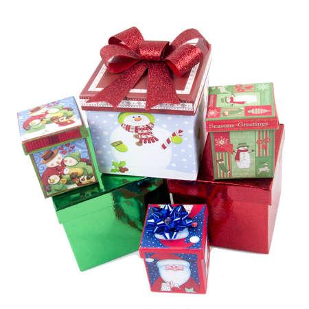 december 25th: Boxed and decorated Christmas presents isolated on white background