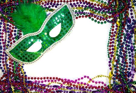 masquerade masks: Mardi Gras masquerade mask on a background of colorful Mardi Gras Beads