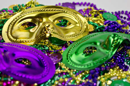 Mardi Gras masquerade mask on a background of colorful Mardi Gras Beads