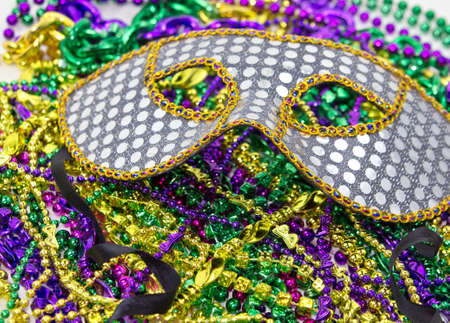 masquerade masks: Mardi Gras masquerade mask on a background of colorful Mardi Gras Beads
