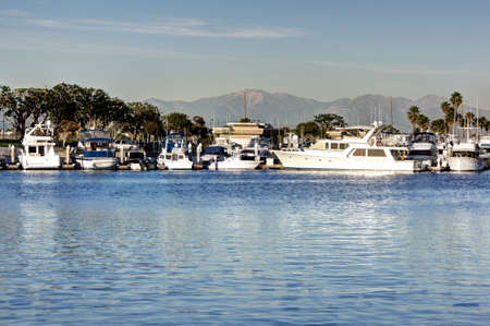 Snow capped Mt  Baldy mountain seen through a marina of boats Stock Photo