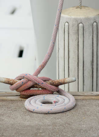 boater: White boat fenders and dock line attached to boat