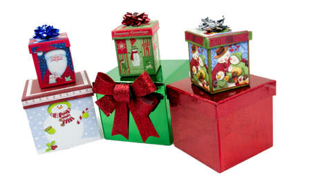 yule tide: Boxed and decorated Christmas presents isolated on white background