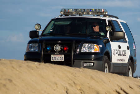 Huntington Beach Police officers crusing the beach on patrol Editorial
