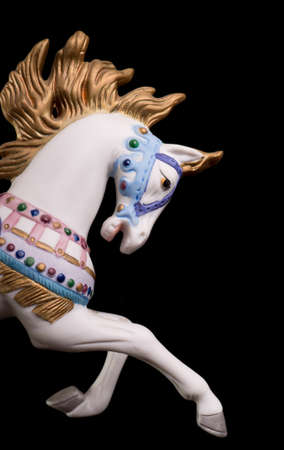 marry go round: Colorful carousel horse isolated on black background