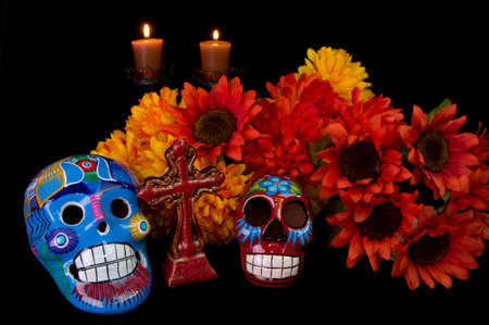Dia De Los Muertos  Day of the Dead  Alter with decorated sugar skulls, marigold flowers, candles, and cross  Traditional Mexican offering to loved ones
