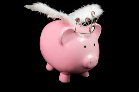 pig wings: pInk piggy bank with wings on black background