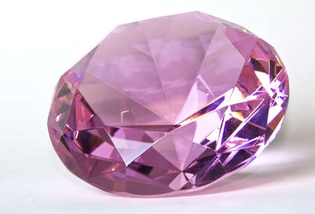 Faceted round cut pink kunzite gemstone on white background Stock Photo