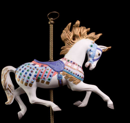 horse harness: Colorful carousel horse isolated on black background